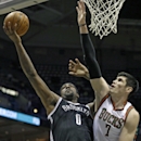 Brooklyn Nets' Andray Blatche (0) puts up a shot against Milwaukee Bucks' Ersan Ilyasova in the first half of an NBA basketball game, Saturday, March 1, 2014, in Milwaukee The Associated Press