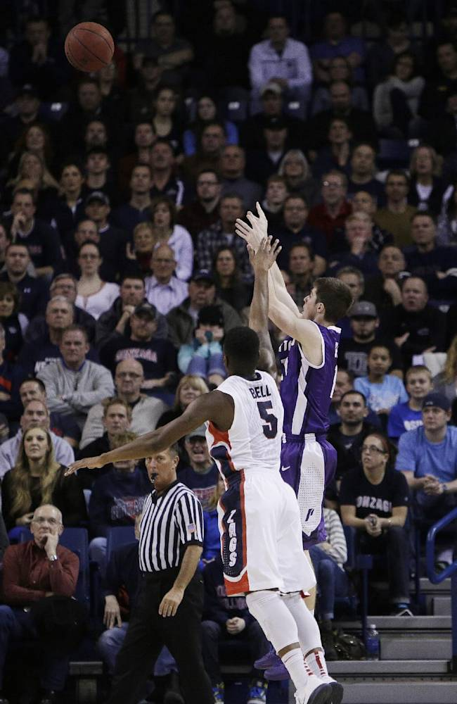 Portland's Bobby Sharp, right, attempts a jump shot against Gonzaga's Gary Bell Jr. (5) during the second half of an NCAA college basketball game, on Wednesday, Feb. 5, 2014, in Spokane, Wash. Gonzaga won 71-66