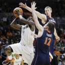 Virginia's Paul Jeperson (2) and Joe Harris (12) pressure Miami's Durant Scott (1) during the second half of an NCAA college basketball game in Coral Gables, Fla., Tuesday, Feb. 19, 2013. Miami won 54-50. (AP Photo/J Pat Carter)