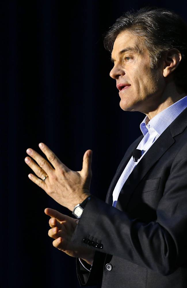 Dr. Mehmet Oz speaks during a safety clinic hosted by the NFL and the Chicago Bears for mothers of youth football players, Tuesday, Oct. 29, 2013, at Halas Hall in Lake Forest, Ill