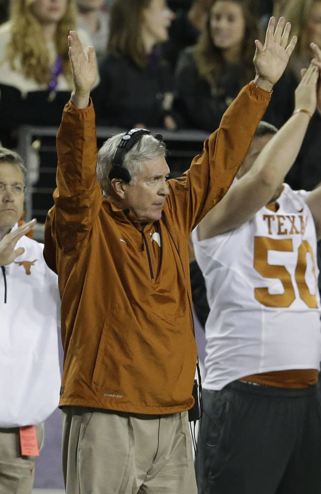 Texas head coach Mack Brown celebrates his team scoring a field goal during the second half of an NCAA college football game against TCU  Sunday, Oct. 27, 2013, in Fort Worth, Texas