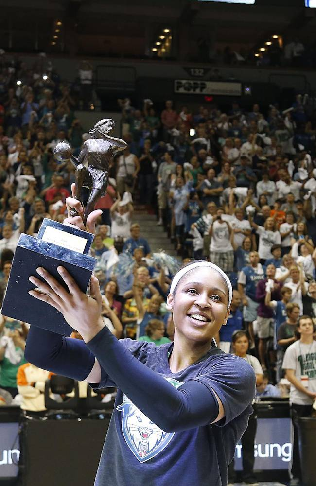 Minnesota Lynx forward Maya Moore celebrates with fans after receiving her WNBA MVP award prior to Game 1 of a WNBA basketball Western Conference semifinal against the San Antonio Stars, Thursday, Aug. 21, 2014, in Minneapolis