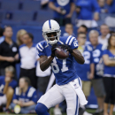 Indianapolis Colts wide receiver Reggie Wayne makes a catch before an NFL football game against the Tennessee Titans in Indianapolis, Sunday, Sept. 28, 2014. The Associated Press