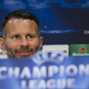 Manchester United's Ryan Giggs smiles during a press conference at Old Trafford Stadium, Manchester, England, Monday, March 31, 2014. Manchester United will play Bayern Munich in a Champions League quarter final first leg soccer match on Tuesday