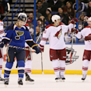 St. Louis Blues defenseman Kevin Shattenkirk (22) skates away as Phoenix Coyotes players celebrate Mikkel Boedker's first period goal during an NHL hockey game on Tuesday, Nov. 12, 2013, in St. Louis The Associated Press