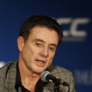 Louisville basketball coach Rick Pitino answers a question at the Atlantic Coast Conference NCAA college basketball media day in Charlotte, N.C., Wednesday, Oct. 29, 2014. (AP Photo/Nell Redmond)