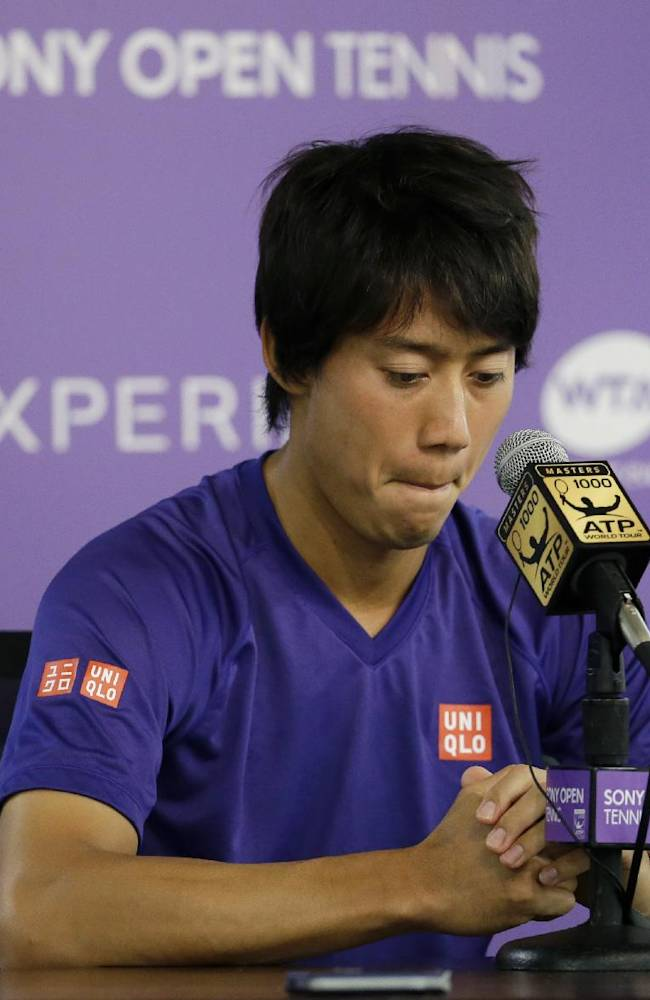 Kei Nishikori, of Japan, looks down at a news conference after withdrawing from his semifinal match against Novak Djokovic due to a left groin injury at the Sony Open Tennis tournament, Friday, March 28, 2014, in Key Biscayne, Fla