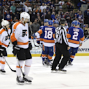 New York Islanders center Ryan Strome (18), center Anders Lee (27), left wing Josh Bailey (12) and defenseman Nick Leddy (2) celebrate Bailey's goal as Philadelphia Flyers defenseman Michael Del Zotto (15) and defenseman Andrew MacDonald (47) react in the