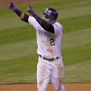 Colorado Rockies' Troy Tulowitzki celebrates after hitting a home run off of San Francisco Giants' Madison Bumgarner during the fourth inning of a baseball game, Tuesday, April 22, 2014, in Denver The Associated Press