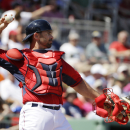 In this March 4, 2014, file photo, Boston Red Sox catcher Dan Butler returns the ball to pitcher Clay Buchholz during the first inning of an exhibition baseball game against the Tampa Bay Rays in Fort Myers, Fla. The Nationals have acquired Butler from th