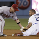 Los Angeles Dodgers' Matt Kemp, right, is safe with a steal of second under the tag by Arizona Diamondbacks second baseman Aaron Hill during fourth inning of a baseball game in Los Angeles, Friday, April 18, 2014 The Associated Press