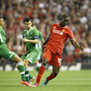 Liverpool's Mario Balotelli, right, evades Ludogorets' Anicet Abel, left, and Svetoslav Dyakov during the Champions League Group B soccer match between Liverpool and Ludogorets at Anfield Stadium in Liverpool, England, Tuesday, Oct. 16, 2014