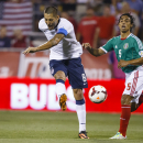 Sep 10, 2013; Columbus, OH, USA; United States forward Clint Dempsey (8) takes a shot as Mexico midfielder Fernado Arce (5) defends in the first half at Columbus Crew Stadium. United States won 2-0. (Rick Osentoski-USA TODAY Sports)