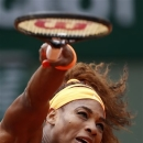 Serena Williams, of the USA, serves the ball to Georgia's Anna Tatishvili during their first round match of the French Open tennis tournament at the Roland Garros stadium Sunday, May 26, 2013 in Paris. (AP Photo/Petr David Josek)