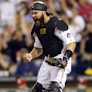 FILE - In this Aug. 25, 2014, file photo, Pittsburgh Pirates catcher Russell Martin reacts after the Pirates completed an inning-ending bases-loaded double play on a grounder by St. Louis Cardinals' Oscar Taveras in the sixth inning of a baseball game in Pittsburgh. A person with knowledge of the deal says the Toronto Blue Jays and free agent catcher Russell Martin have agreed to a five-year, $82 million contract. Martin took a physical Monday, Nov 17 and the Blue Jays are expected to finalize the deal Tuesday, according to the person, who spoke on condition of anonymity because the deal was not yet complete. (AP Photo/Keith Srakocic, File)