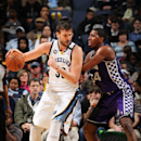 MEMPHIS, TN - FEBRUARY 12: Marc Gasol #33 of the Memphis Grizzlies controls the ball against Jason Thompson #34 of the Sacramento Kings on February 12, 2013 at FedExForum in Memphis, Tennessee. (Photo by Joe Murphy/NBAE via Getty Images)