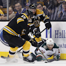 Minnesota Wild right wing Nino Niederreiter (22), of Switzerland, battles Boston Bruins left wing Milan Lucic (17) and center David Krejci (46), of the Czech Republic, for the puck in the first period of an NHL hockey game in Boston, Tuesday, Oct. 28, 201