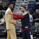 New Orleans Pelicans shooting guard Austin Rivers, right, laughs with power forward Anthony Davis before an NBA basketball game against the Dallas Mavericks in New Orleans, Wednesday, Dec. 4, 2013. Davis is out for four to six weeks for a hand injury he