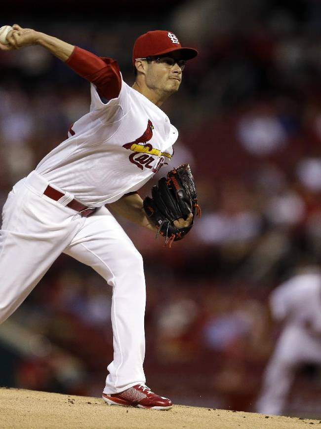 St. Louis Cardinals starting pitcher Joe Kelly throws during the first inning of a baseball game against the Milwaukee Brewers, Thursday, Sept. 12, 2013, in St. Louis