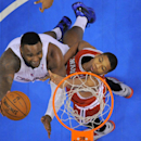 Los Angeles Clippers forward Glen Davis, left, puts up a shot as Milwaukee Bucks guard Giannis Antetokounmpo, of Greece, defends during the first half of an NBA basketball game, Monday, March 24, 2014, in Los Angeles The Associated Press