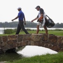 FILE - In this Aug. 15, 2009, file photo, Tiger Woods, left, crosses a bridge on the 16th fairway with caddie Steve Williams during the third round of the PGA Championship golf tournament at Hazeltine National Golf Club in Chaska, Minn. Organizers of golf's prestigious Ryder Cup have encountered skepticism from Minnesota state officials as they seek logistical assistance and sponsorships for the 2016 event at Hazeltine. (AP Photo/Morry Gash, File)