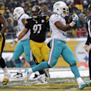 Miami Dolphins running back Daniel Thomas (33) runs into the end zone untouched for a touchdown in the second half of an NFL football game against the Pittsburgh Steelers in Pittsburgh, Sunday, Dec. 8, 2013 The Associated Press