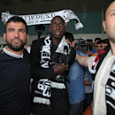 Soccer fans of Besiktas greet Demba Ba, a former Chelsea player from Senegal, at Ataturk Airport in Istanbul, Turkey, Wednesday, July 16, 2014. Ba will sign a three-year contract with Besiktas soccer club
