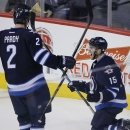 Winnipeg Jets' Matt Halischuk (15) and Adam Pardy (2) celebrate Halischuk's goal against the Minnesota Wild during the third period of an NHL game in Winnipeg, Manitoba, Saturday, Nov. 23, 2013 The Associated Press