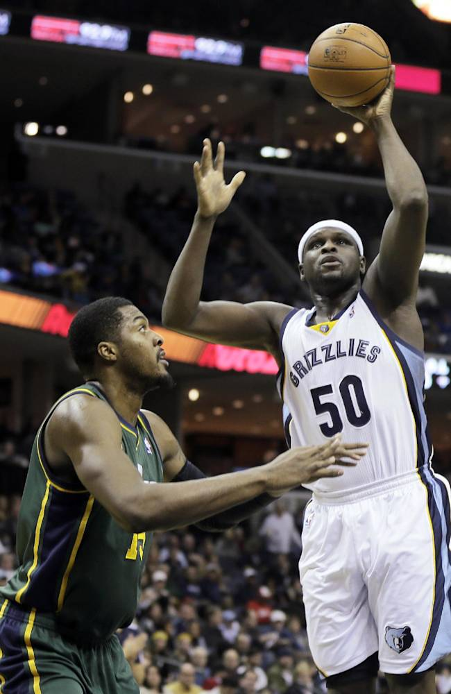 Memphis Grizzlies' Zach Randolph (50) shoots over Utah Jazz's Derrick Favors, left, in the first half of an NBA basketball game in Memphis, Tenn., Monday, Dec. 23, 2013