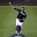 San Diego Padres' Tyson Ross, rear, throws in warm ups with his brother and fellow pitcher Joe Ross, front, during spring training baseball practice, Sunday, Feb. 16, 2014, in Peoria, Ariz The Associated Press