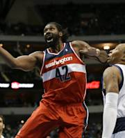 Washington Wizards' Nene Hilario (42), of Brazil, lands an elbow to the face of Dallas Mavericks' Shawn Marion (0) on a shot attempt in the first half of an NBA basketball game, Tuesday, Nov. 12, 2013, in Dallas. (AP Photo/Tony Gutierrez)