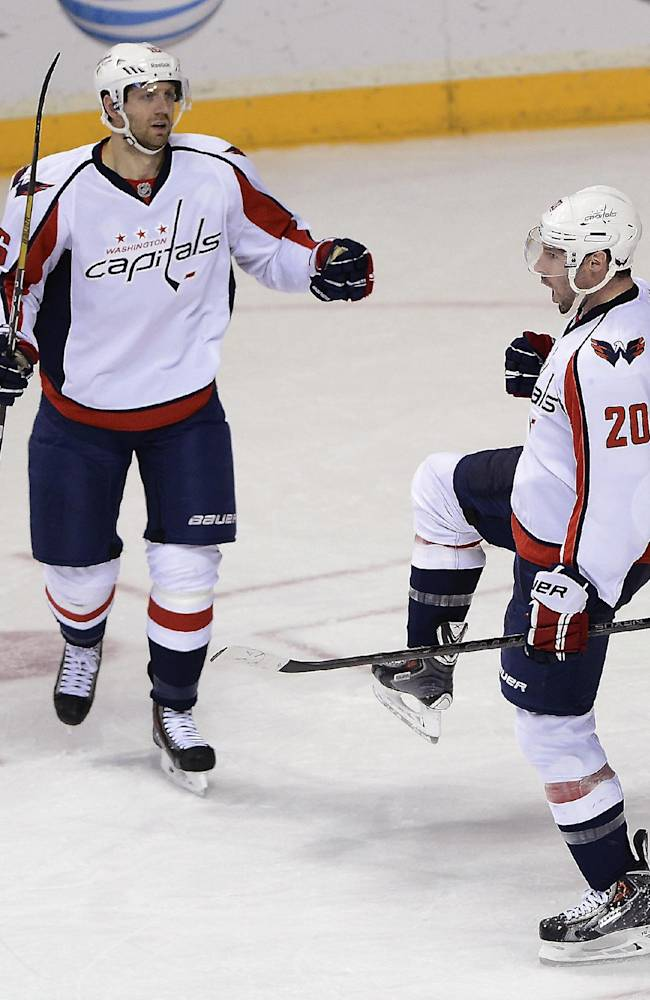 Washington Capitals right wing Troy Brouwer (20) celebrates with Eric Fehr (16) after scoring a goal in the second period of an NHL hockey game against the Nashville Predators on Sunday, March 30, 2014, in Nashville, Tenn
