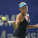 Donna Vekic from Croatia return a shot against Karolina Pliskova from Czech Republic during the Women Single's semi final match of the WTA BMW Malaysian Open 2014 in Kuala Lumpur, Malaysia, Saturday, April 19, 2014. (AP Photo/Vincent Thian)