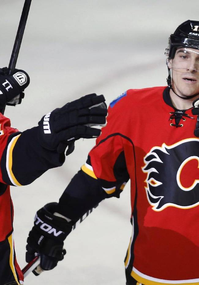 Calgary Flames' Mike Cammalleri, right, celebrates his goal with Mikael Backlund, from Sweden, during the first period of an NHL hockey game against the Anaheim Ducks in Calgary, Alberta, Wednesday, March 12, 2014