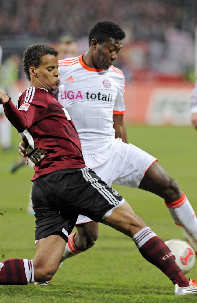 In this Nov. 17, 2012, file photo, Nuremberg's Timothy Chandler of the U.S., left, and Bayern's David Alaba of Austria, right, challenge for the ball during a soccer match in Nuremberg, southern Germany.  U.S. team coach Jurgen Klinsman named  Chandler to the team's 30-man preliminary roster on Monday May 12, 2014