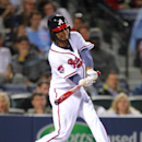 Atlanta Braves' Ervin Santana (30) singles in the fifth inning of a baseball game against the New York Mets, Wednesday, April 9, 2014, in Atlanta The Associated Press