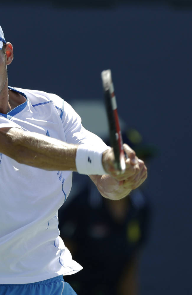 Blaz Rola, of Slovenia, returns a shot against Fernando Verdasco, of Spain, during the opening round of the 2014 U.S. Open tennis tournament, Monday, Aug. 25, 2014, in New York