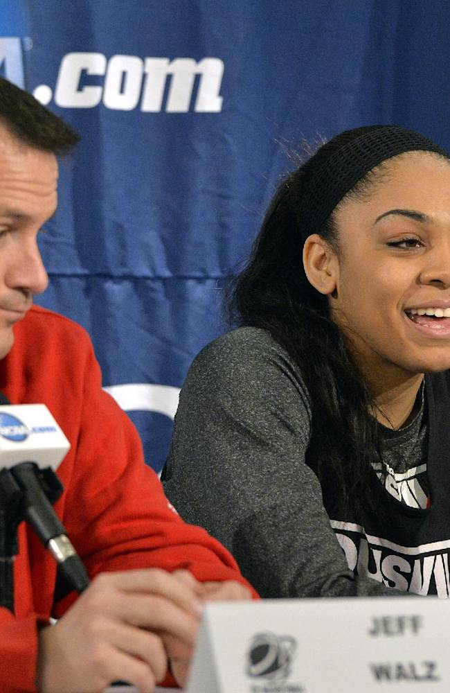 Louisville's Bria Smith, right and Louisville head coach Jeff Walz listen to a question during a news conference for the Louisville Regional final in the women's NCAA college basketball tournament Monday, March 31, 2014, in Louisville, Ky. Louisville plays Maryland on Tuesday