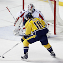Nashville Predators left wing James Neal (18) scores the winning goal against Washington Capitals goalie Braden Holtby (70) in the third period of an NHL hockey game Friday, Jan. 16, 2015, in Nashville, Tenn. It was the second goal of the game for Neal an