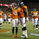 Denver Broncos wide receiver Emmanuel Sanders (10) salutes after scoring his third touchdown of the night, as teammate Orlando Franklin (74) joins him during the second half of an NFL football game against the San Diego Chargers, Thursday, Oct. 23, 2014, in Denver. (AP Photo/Jack Dempsey)