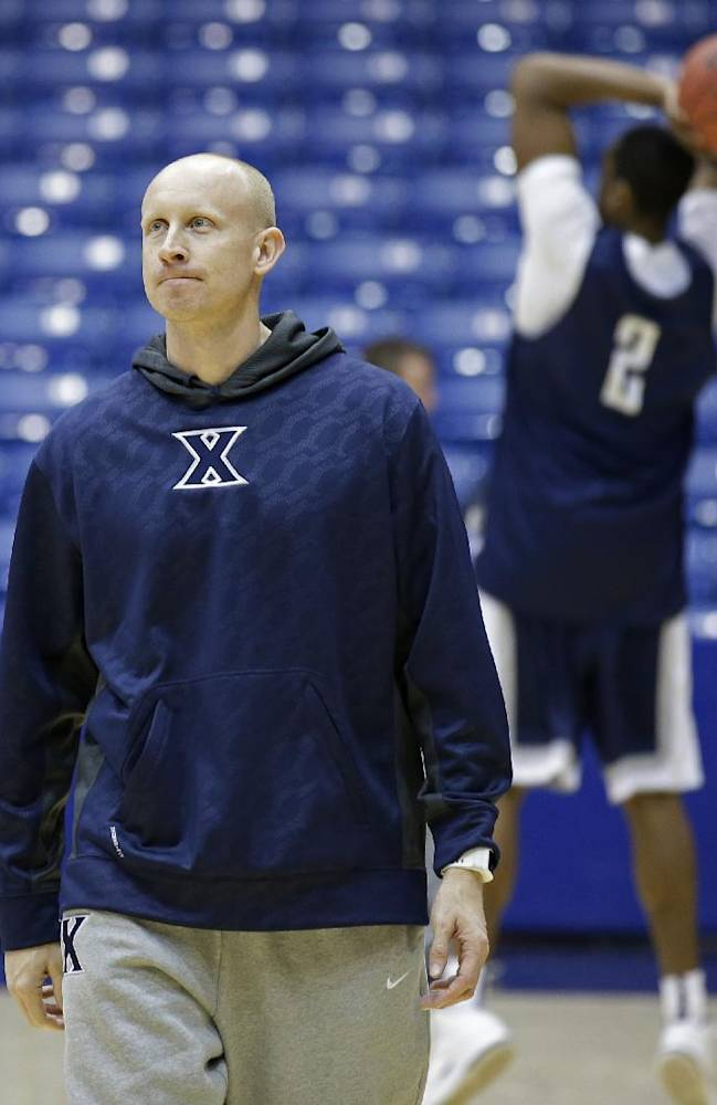 Xavier head coach Chris Mack watches during practice for an NCAA college basketball tournament game, Monday, March 17, 2014, in Dayton, Ohio. NC State plays Xavier on Tuesday in a first round game
