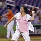 Honorary bat girl and breast cancer survivor  Ana Sanchez  throws out a ceremonial first pitch before the start of the MLB American National League baseball game between the Miami Marlins and the Arizona Diamondbacks Sunday, May 19, 2013, in Miami. Sanchez, who was diagnosed with breast cancer in 2010, and has undergone a partial mastectomy, chemotherapy and 33 rounds of radiation, was selected to represent the Marlins to raise awareness of breast cancer. (AP Photo/Wilfredo Lee)