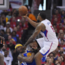 Los Angeles Clippers center DeAndre Jordan, right, puts up a shot as Golden State Warriors center Jermaine O'Neal defends during the second half in Game 1 of an opening-round NBA basketball playoff series, Saturday, April 19, 2014, in Los Angeles. The War