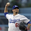 Los Angeles Dodgers starter Josh Beckett pitches to the Washington Nationals in the first inning of a baseball game in Los Angeles Monday, May 13, 2013. (AP Photo/Reed Saxon)