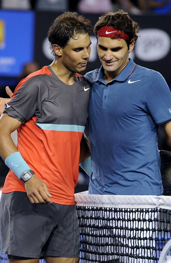 Rafael Nadal of Spain, left, is congratulated by Roger Federer of  Switzerland at the net after Nadal won their semifinal final at the Australian Open tennis championship in Melbourne, Australia, Friday, Jan. 24, 2014