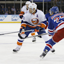 New York Rangers Ryan McDonagh (27) defends as New York Islanders right wing Kyle Okposo (21) loses track of the puck during the first period of an NHL hockey game at Madison Square Garden in New York, Tuesday, Jan. 13, 2015 The Associated Press