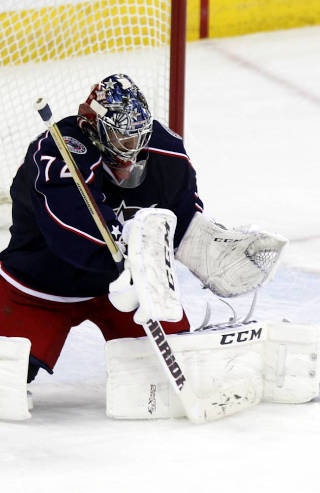 Columbus Blue Jackets goalie Sergi Bobrovsky, of Russia,  stops a shot against the New York Islanders in the third period of an NHL hockey game in Columbus, Ohio, Sunday, April 6, 2014. The Blue Jackets won 4-0