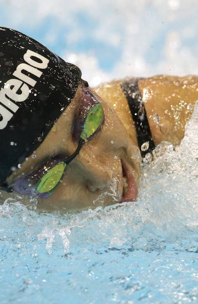 Germany's Alexandra Wenk competes in a women's 100m butterfly first round heat at the LEN Swimming European Championships in Berlin, Germany, Thursday, Aug. 21, 2014