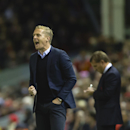 In this photo taken Tuesday, Oct. 28, 2014, Swansea's manager Garry Monk issues instructions during his team's English League Cup soccer match between Liverpool and Swansea at Anfield Stadium, Liverpool, England. Monk is to meet referees' boss Mike Riley