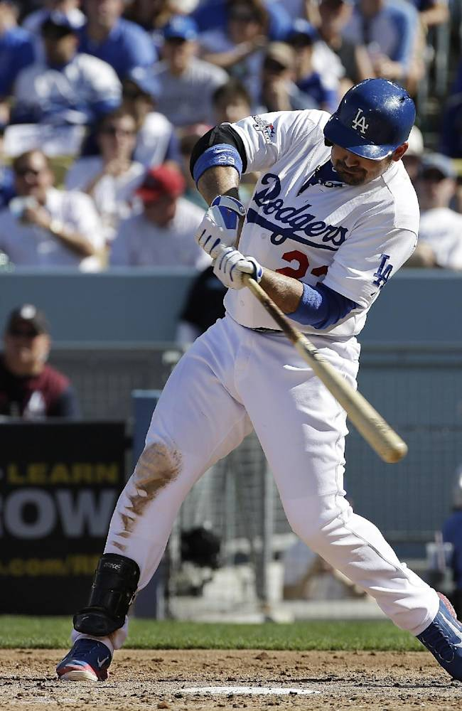 Los Angeles Dodgers' Adrian Gonzalez hits a home run during the third inning of Game 5 of the National League baseball championship series against the St. Louis Cardinals Wednesday, Oct. 16, 2013, in Los Angeles